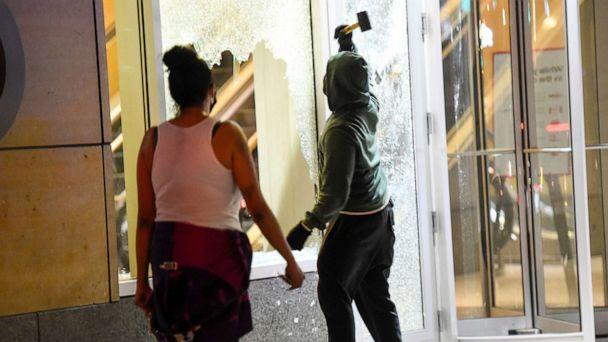 PHOTO: Windows are smashed at Target headquarters as people clash with police after a homicide suspect killed himself as police closed in on him in downtown Minneapolis, Aug. 2020. (Craig Lassig/EPA via Shutterstock)