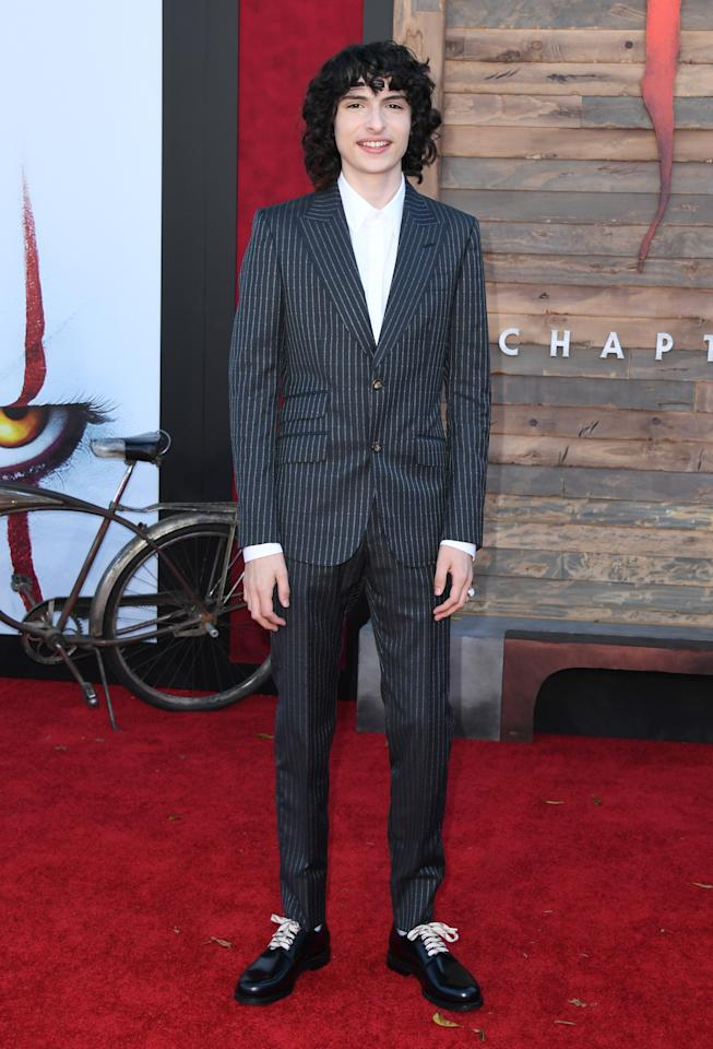 "<em>Stranger Things</em> star <a href=""http://teenvogue.com/tag/finn-wolfhard"">Finn Wolfhard</a> is a bonafide <a href=""https://www.teenvogue.com/story/stranger-things-finn-wolfhard-stars-in-the-latest-yves-saint-laurent-campaign?mbid=synd_yahoo_rss"">fashion model</a> these days, and he showed off his stylish side at the premiere of <em>It Chapter Two</em> in a classic fitted pinstriped suit, white shirt, and shiny black shoes with white laces."
