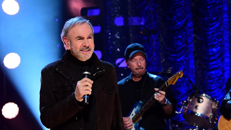 Hands washing hands: Neil Diamond pens amended version of Sweet Caroline