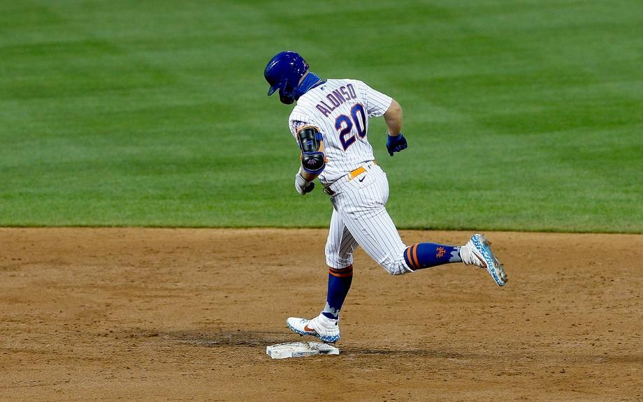 Pete Alonso rounds the bases after hitting a home run