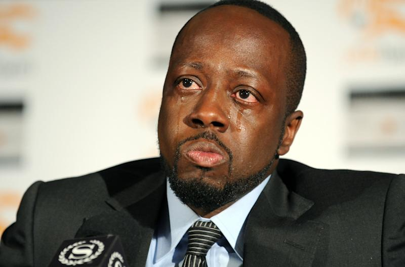 """FILE - This Jan. 18, 2010 file photo shows Haitian-born musician Wyclef Jean overcome with emotion while discussing his visit to earthquake-stricken Haiti and how is organization, Yele Haiti, is helping with relief efforts in New York. Jean kicked his Yele Haiti Foundation into overdrive to help survivors, and the urgency to get Haitians back to work drove Jean to announce his candidacy during Haiti's 2010 presidential elections. He has written an autobiography, """"Purpose"""" which is on sale Tuesday, Sept. 18, 2012. (AP Photo/Diane Bondareff, file)"""