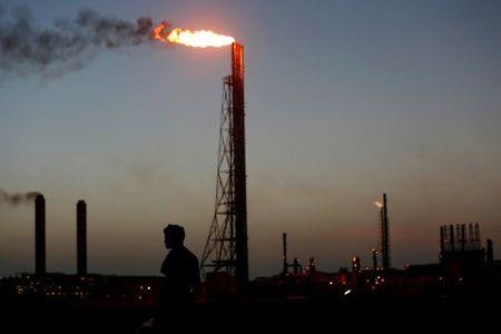 A man stands close to the Cardon refineryn which belongs to the Venezuelan state oil company PDVSAn in Punto Fijo