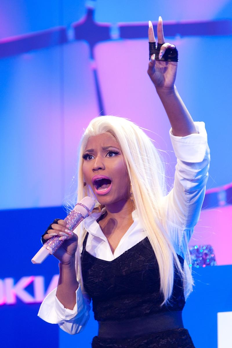 """FILE - In this April 6, 2012 file photo, singer Nicki Minaj performs in Times Square during a show in New York. Last week Nicki Minaj released her sophomore album, """"Pink Friday: Roman Reloaded,"""" which includes the hit song """"Starships"""" and collaborations with Chris Brown, Lil Wayne, Drake, Rick Ross and Nas. (AP Photo/John Minchillo, file)"""