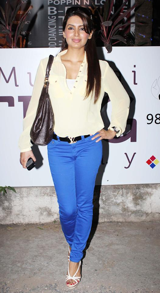 Adding colour to Geeta Basra's look are her pants. We like how she's teamed a simple off-white shirt with them