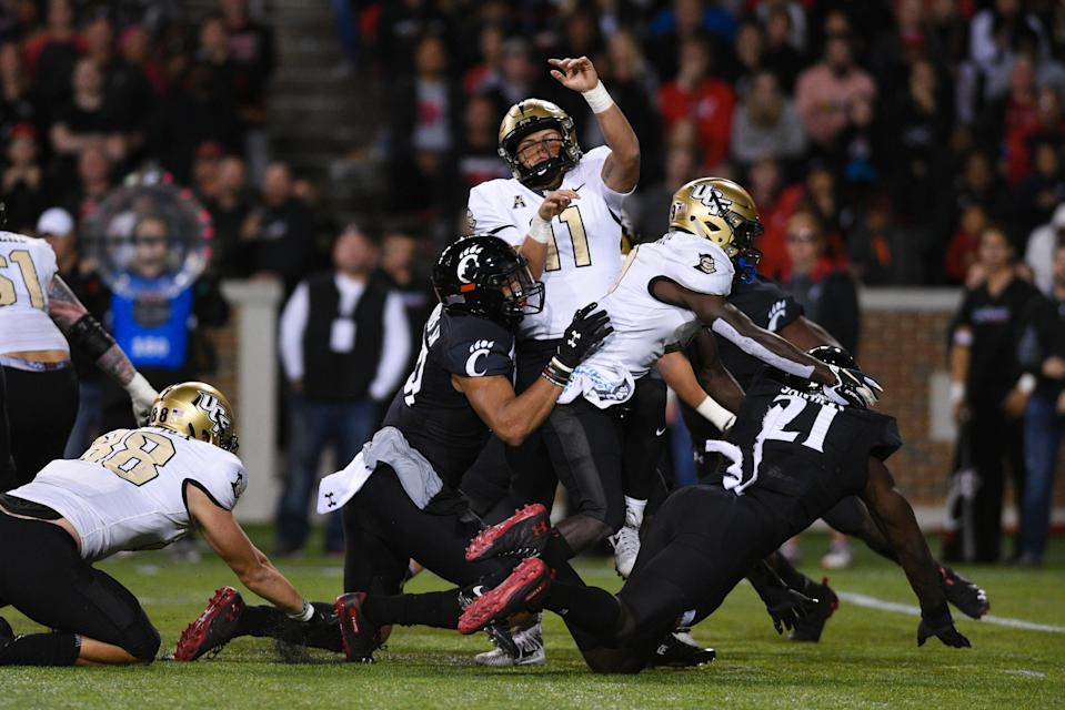 CINCINNATI, OH - OCTOBER 04: UCF (QB) Dillon Gabriel (11) tackled by Cincinnati (LB) Darrian Beavers (27) during a college football game between the University of Central Florida Knights (UCF) and Cincinnati Bearcats on October 4, 2019 at Nippert Stadium in Cincinnati, OH  (Photo by James Black/Icon Sportswire via Getty Images)