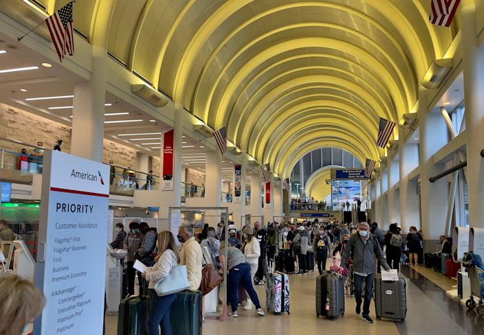 Passengers check in at the American Airlines counters at the Los Angeles International Airport (LAX) on April 24, 2021. (Photo by Daniel SLIM / AFP) (Photo by DANIEL SLIM/AFP via Getty Images)