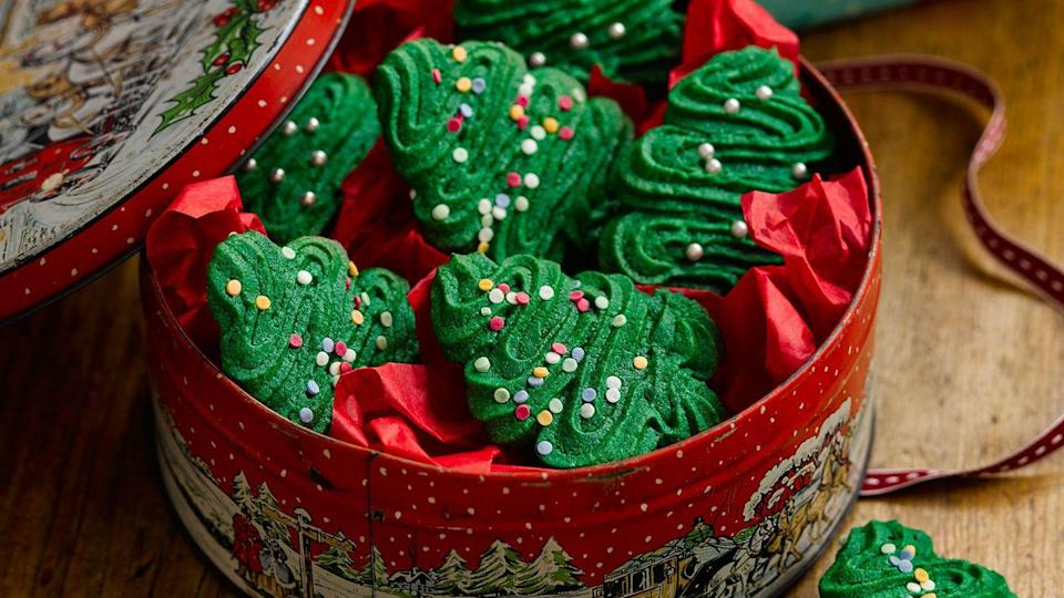 """<p>These piped <a href=""""https://www.goodhousekeeping.com/uk/food/food-reviews/g551382/10-best-christmas-cookie-recipes/"""" rel=""""nofollow noopener"""" target=""""_blank"""" data-ylk=""""slk:Christmas cookies"""" class=""""link rapid-noclick-resp"""">Christmas cookies</a> ('spritz' means to squirt or spray in German) hold their definition well as there is no chemical raising agent in the dough mix. If you prefer, leave out the green food colouring.</p><p><strong>Recipe: <a href=""""https://www.goodhousekeeping.com/uk/food/recipes/a557426/christmas-spritz-cookies/"""" rel=""""nofollow noopener"""" target=""""_blank"""" data-ylk=""""slk:Christmas spritz cookies"""" class=""""link rapid-noclick-resp"""">Christmas spritz cookies</a></strong></p>"""