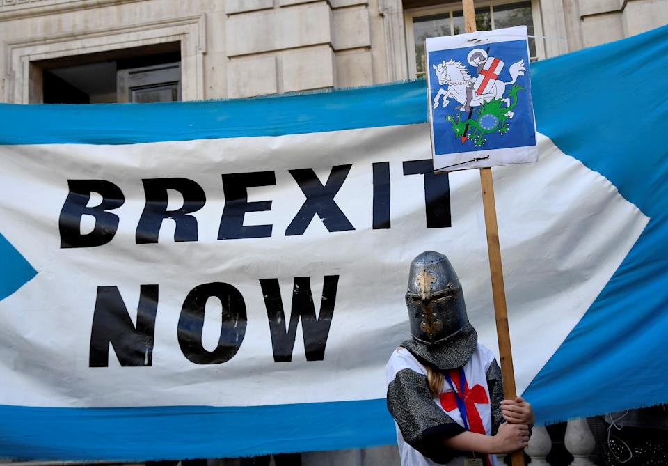 A pro-Brexit supporter holds a placard outside Cabinet Office in London, Britain August 29, 2019. REUTERS/Toby Melville