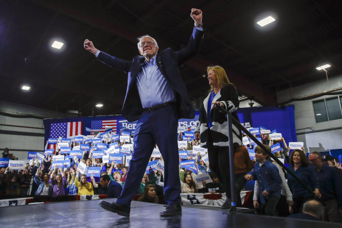 Democratic presidential candidate Sen. Bernie Sanders, I-Vt., accompanied by his wife Jane O'Meara Sanders, speaks during a primary night election rally in Essex Junction, Vt., Tuesday, March 3, 2020. (AP Photo/Matt Rourke)