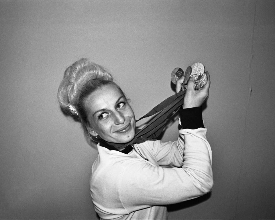 Vera Caslavska of Czechoslovakia displays the four medals she won in Olympic gymnastic competition.  Vera won three gold and one silver to add to the gold and silver ones she won.  She's the first competitor in Olympic history to win four individual gold medals in one Olympics.  (Photo by Bettmann Archive/Getty Images)