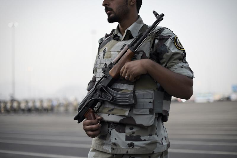 A member of the Saudi special police stands guard during a military parade in Mecca on September 17, 2015