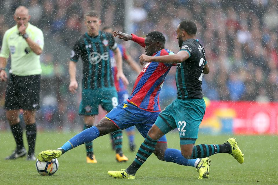 Crystal Palace's Jeffrey Schlupp (left) and Southampton's Nathan Redmond tussle in the rain