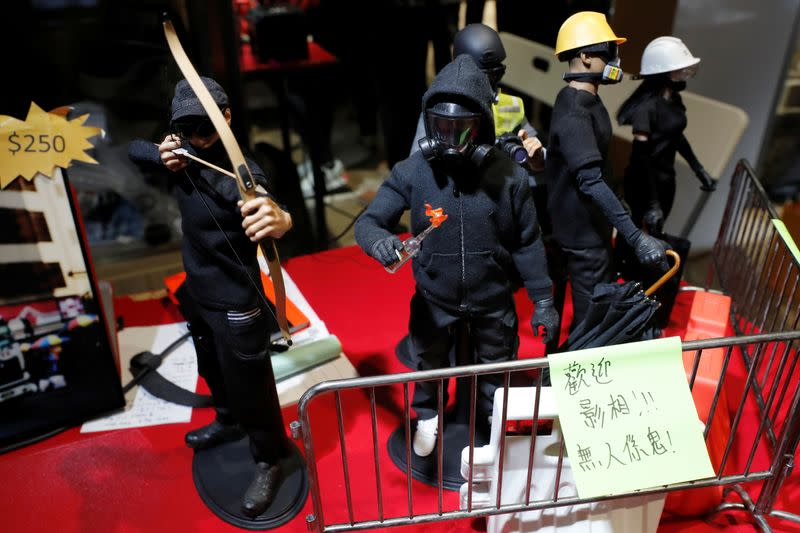 Figurines of black-clad protesters are see at a booth of independent fairs, selling protest-themed artwork, toys and accessories, ahead of Lunar New Year in Hong Kong