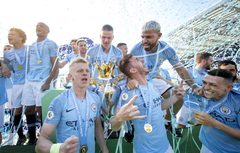 BRIGHTON, ENGLAND - MAY 12: Oleksandr Zinchenko, Ederson, Aymeric Laporte, Sergio Aguero and Phil Foden celebrate with the Premier League trophy after the Premier League match between Brighton & Hove Albion and Manchester City at American Express Community Stadium on May 12, 2019 in Brighton, United Kingdom. (Photo by Michael Regan/Getty Images)