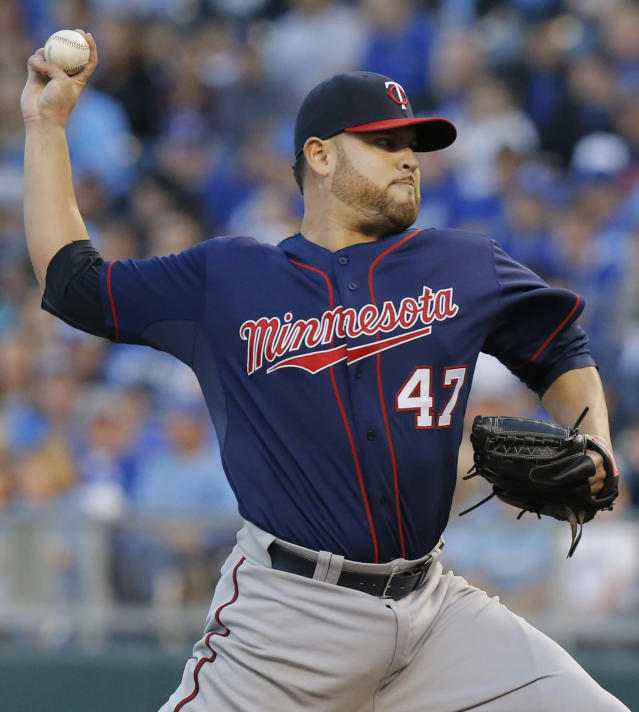 Minnesota Twins starting pitcher Ricky Nolasco (47) delivers to a Kansas City Royals batter during the first inning of a baseball game at Kauffman Stadium in Kansas City, Mo., Friday, April 18, 2014. (AP Photo/Orlin Wagner)