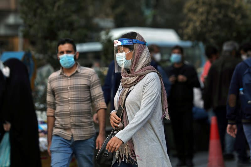 FILE PHOTO: An Iranian woman is seen in Tehran, Iran, Oct 24, 2020 amid a surge in coronavirus infections.