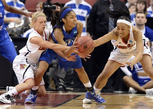 Middle Tennessee's Kortni Jones, center, looks for help from the defensive pressure of Louisville's Shelby Harper, left, and Cortnee Walton during the second half of a first-round game in the women's NCAA college basketball tournament in Louisville, Ky., Sunday, March 24, 2013. Louisville won 74-49. (AP Photo/Timothy D. Easley)