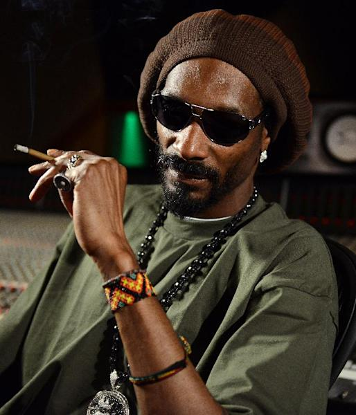In this Tuesday, March 5, 2013 photo, Snoop Lion poses for a portrait at the Westlake Recording Studios in Los Angeles. How committed is Snoop Dogg to his new moniker Snoop Lion? While promoting an accompanying documentary that tracks his trip to Jamaica and exploration of the Rastafarian culture and religion, Snoop says Lion is less a lifestyle transformation than a personal evolution. (Photo by Jordan Strauss/Invision/AP)