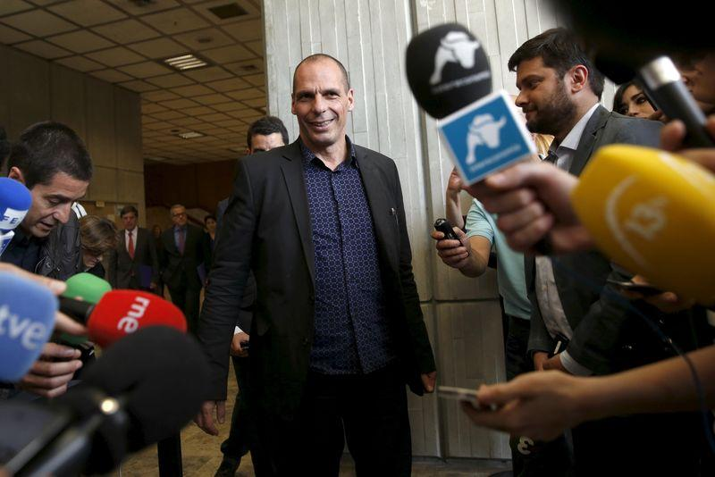 Greek Finance Minister Varoufakis arrives to make a statement to the media after meeting with Spanish Economy Minister Luis de Guindos in Madrid