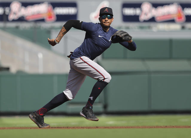 Atlanta Braves Johnan Camargo plays third base and runs down a ground ball as position players reported to baseball spring training Monday, Feb. 17, 2020, in North Port, Fla. (Curtis Compton/Atlanta Journal-Constitution via AP)