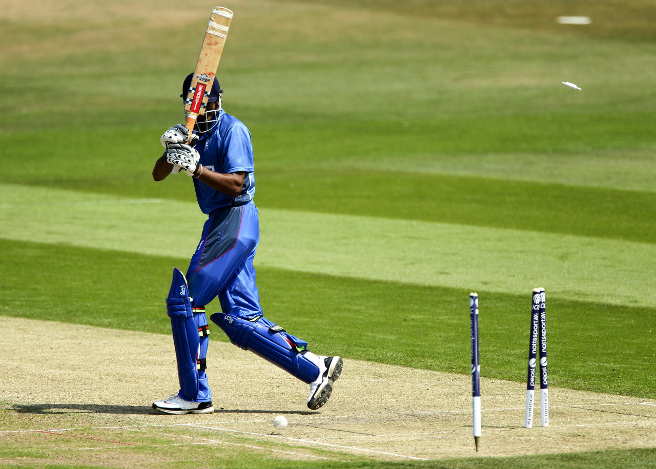 HOVE, ENGLAND - JULY 13: Dilan Arsakulasuriya of Italy looks back at the stumps after being bowled by Anthony Hawkins-Kay of Jersey during the semi final match between Italy and Jersey at the ICC European Division 1 Championship at The Brighton and Hove Jobs County Ground on July 13, 2013 in Hove, England. (Photo by Ben Hoskins/Getty Images)