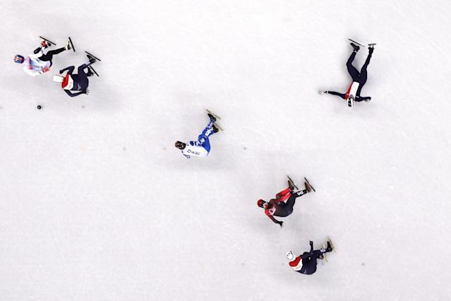 <p>A competitor falls down during the Men's 1500m Short Track Speed Skating final at Gangneung Ice Arena on February 10, 2018 in Gangneung, South Korea. </p>
