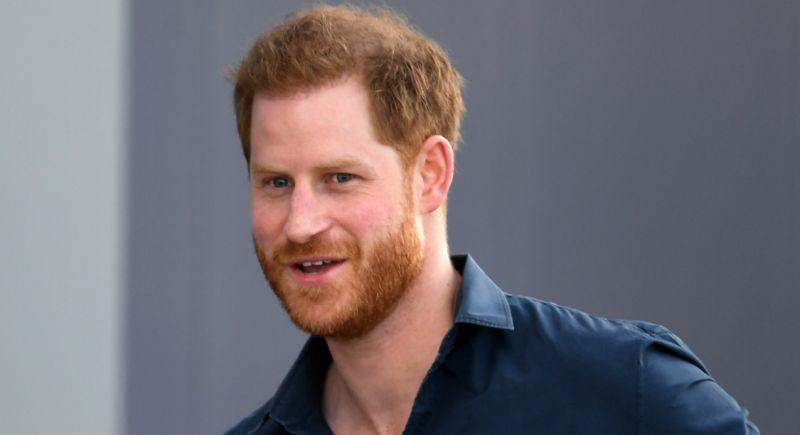 prince harry smiling at the camera