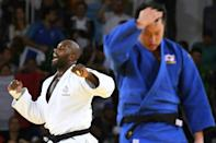 France's Teddy Riner (left) celebrates his second Olympic gold after beating Japan's Hisayoshi Harasawa in the +100kg final at the Rio 2016 Games
