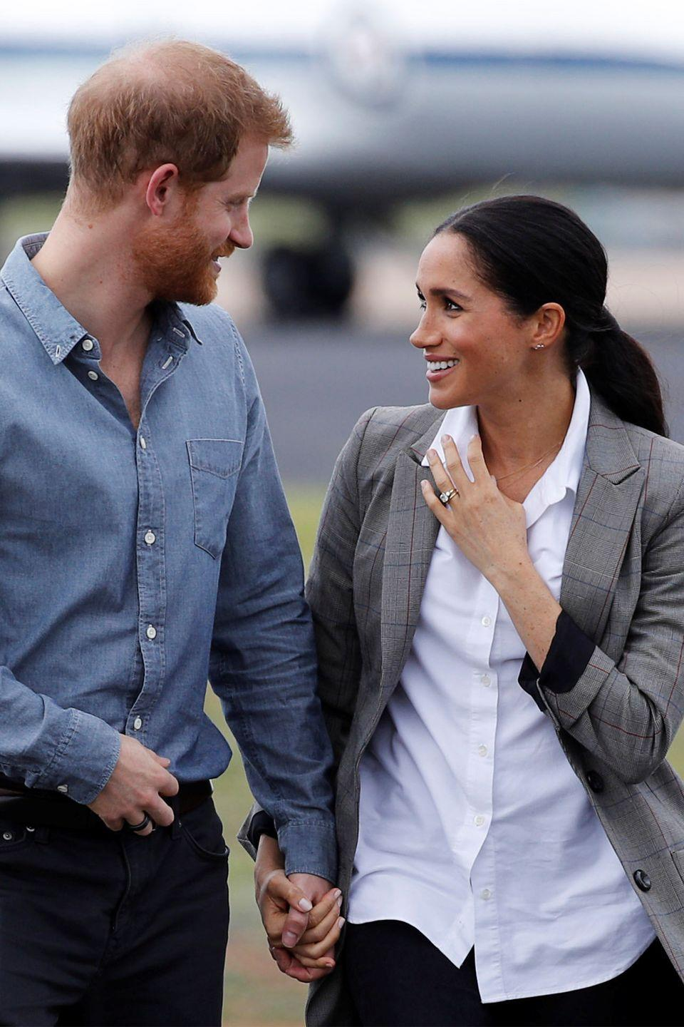 "<p>As they kicked off their official royal tour of Australia, Fiji, Tonga and New Zealand, Meghan and Harry held each other close at Dubbo Airport. This was also right after they announced that they were expecting their <a href=""https://www.harpersbazaar.com/celebrity/latest/a23801934/meghan-markle-prince-harry-royal-baby-news-due-date-name-gender-rumors/"" rel=""nofollow noopener"" target=""_blank"" data-ylk=""slk:first child"" class=""link rapid-noclick-resp"">first child</a>. </p>"