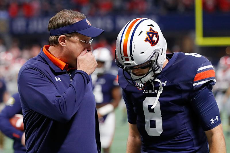 ATLANTA, GA - DECEMBER 02: Head coach Gus Malzahn of the Auburn Tigers talks to his quarterback, Jarrett Stidham #8, prior to the game against the Georgia Bulldogs in the SEC Championship at Mercedes-Benz Stadium on December 2, 2017 in Atlanta, Georgia. (Photo by Kevin C. Cox/Getty Images)