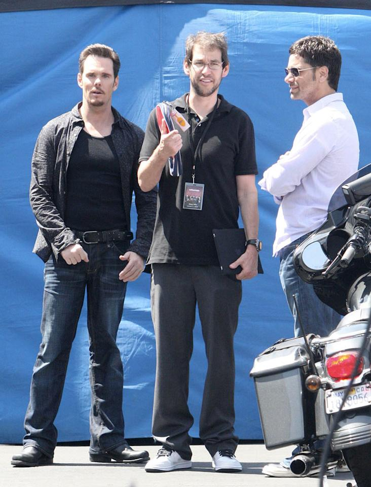 "The sexy star huddled with series regular Kevin Dillon and ""Entourage's"" creator/writer/producer Doug Elin on the downtown LA set. London Entertainment/<a href=""http://www.splashnewsonline.com"" target=""new"">Splash News</a> - May 7, 2010"