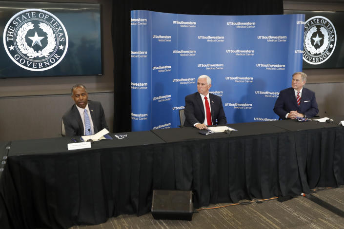 Housing and Urban Development Secretary Ben Carson, left, makes comments as Vice President Mike Pence, center, and Texas Gov. Greg Abbott, right, look on during a news conference after Pence met with Abbott and members of his health care team regarding COVID-19 at the University of Texas Southwestern Medical Center West Campus in Dallas, Sunday, June 28, 2020. (AP Photo/Tony Gutierrez)