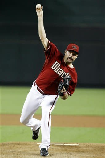 Arizona Diamondbacks pitcher Josh Collmenter (55) throws against the Chicago Cubs in the first inning of a baseball game, Sunday, Sept. 30, 2012, in Phoenix. (AP Photo/Rick Scuteri)