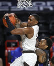 St. Bonaventure's Kyle Lofton, left, and Saint Louis's Jimmy Bell Jr. vie for a rebound during an NCAA college basketball game at the Atlantic 10 men's tournament Saturday, March 6, 2021, in Richmond, Va. (Alexa Welch Edlund/Richmond Times-Dispatch via AP)
