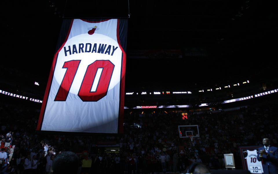 Former Miami Heat guard Tim Hardaway's jersey is hoisted to the rafters during a retirement ceremony before an NBA basketball game between the Heat and the New York Knicks, Wednesday, Oct. 28, 2009, in Miami. (AP Photo/Wilfredo Lee)
