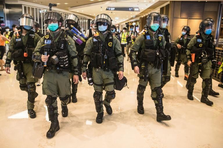 Hong Kong riot police secure a shopping mall after protesters gathered to mark the anniversary of a July 21, 2019 attack on pro-democracy demonstrators at the Yuen Long train station