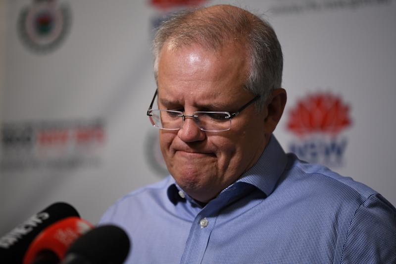 Prime Minister Scott Morrison speaks to the media after touring the NSW Rural Fire Service control room on Sunday.