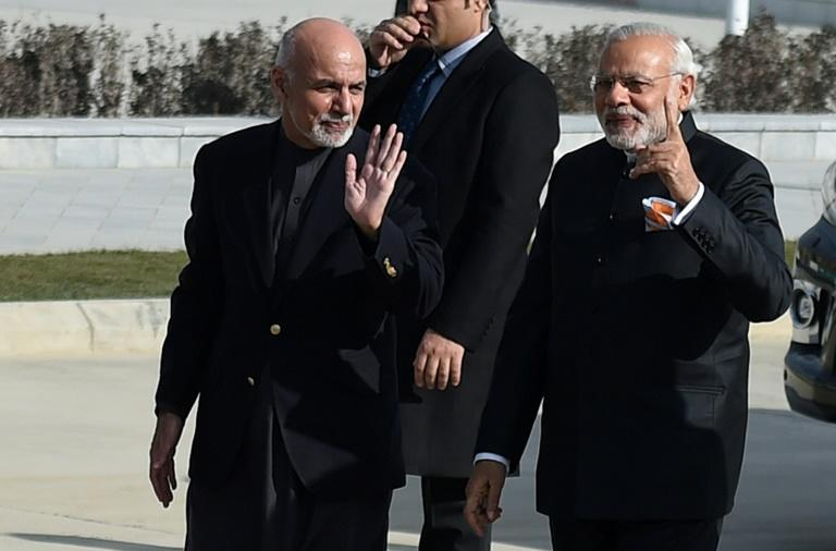 Indian Prime Minister Narendra Modi (right) and Afghan President Ashraf Ghani arrive for a ribbon-cutting ceremony at the inauguration of Afghanistan's new parliament in December 2015