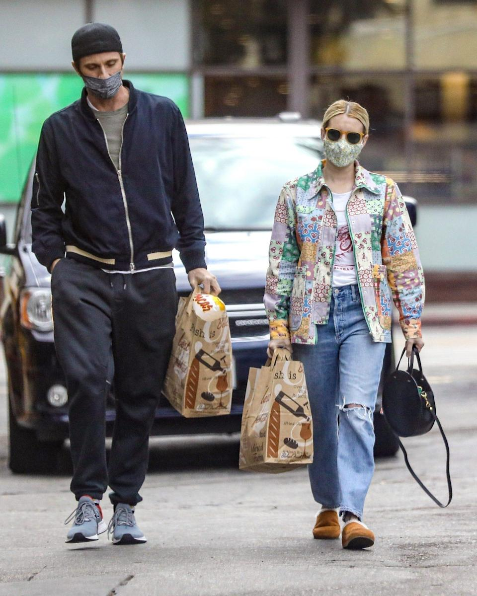 <p>New parents Emma Roberts and Garrett Hedlund make a trip to the grocery store in Beverly Hills on Monday.</p>