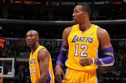 LOS ANGELES, CA - NOVEMBER 9: Kobe Bryant #24 and Dwight Howard #12 of the Los Angeles Lakers wait to resume action against the Golden State Warriors during a game at Staples Center on November 9, 2012 in Los Angeles, California. (Photo by Andrew D. Bernstein/NBAE via Getty Images)