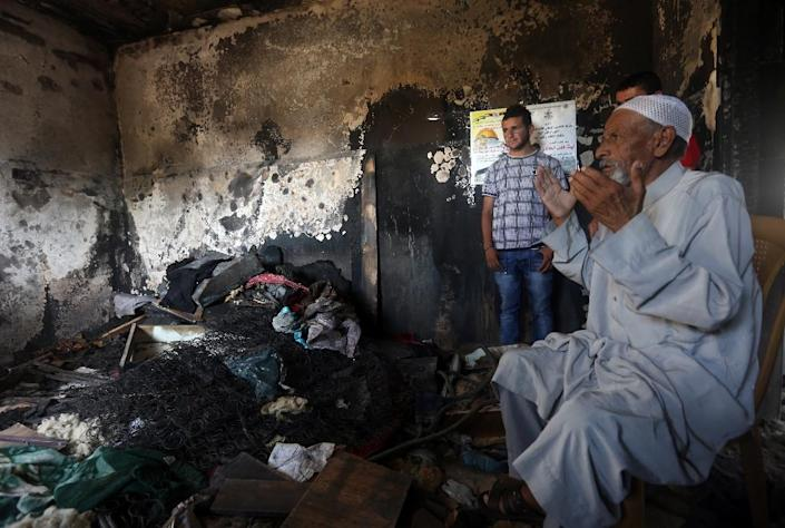 Mohammed, the father of Saad Dawabsha, at the family's burnt-out home in the West Bank village of Duma, the day after his son's funeral on August 9, 2015 (AFP Photo/Jaafar Ashtiyeh)