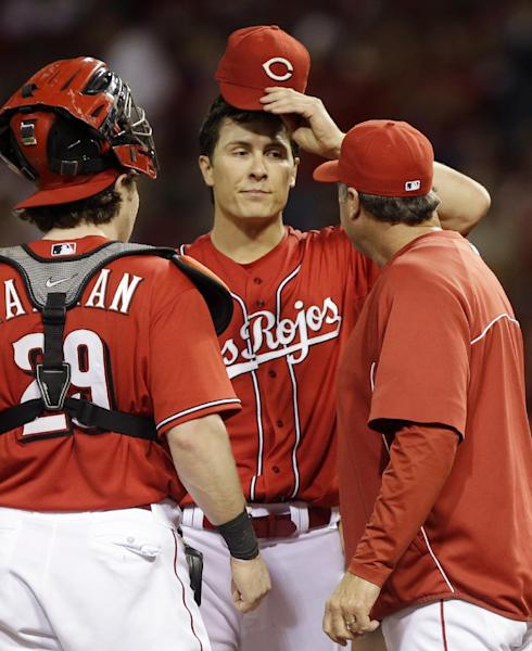 Cincinnati Reds starting pitcher Homer Bailey, center, talks with pitching coach Bryan Price and catcher Ryan Hanigan (29) in the third inning of a baseball game against the Pittsburgh Pirates, Friday, Sept. 27, 2013, in Cincinnati. (AP Photo/Al Behrman)