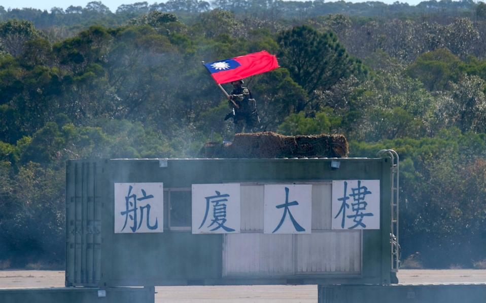 A Taiwanese soldier waves a flag during a drill in Hsinchu military base ahead of the Chinese New Year holiday - Sam Yeh/AFP
