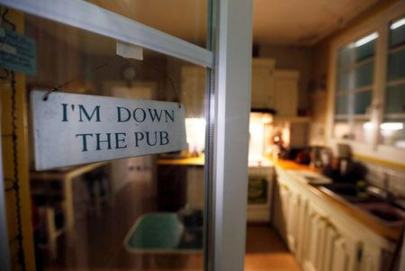 """A sign with the message """"I'm down the Pub"""" hangs on a door of a house in Eymet, France, November 10, 2017. Britons in France are waiting anxiously for EU leaders to decide whether or not to approve a Brexit deal at a December 14-15 summit in Brussels. Picture taken November 10, 2017. REUTERS/Regis Duvignau"""
