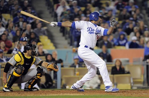 Los Angeles Dodgers' Andre Ethier follows through on an RBI single as Pittsburgh Pirates catcher Rod Barajas watches during the sixth inning of a baseball game, Wednesday, April 11, 2012, in Los Angeles. (AP Photo/Mark J. Terrill)