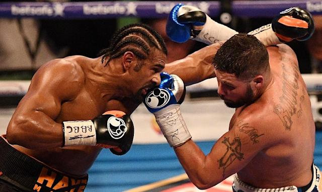 British boxers David Haye (left) and Tony Bellew exchange blows during their heavyweight bout at the O2 arena in London, on March 4, 2017 (AFP Photo/Justin TALLIS)