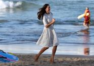 <p>The Duchess of Cambridge looks effortless while running in wedges along Manly beach in Sydney, Australia during her royal tour with Prince William. The couple also brought along a baby Prince George, though he stayed out of the public eye for this portion of their trip. </p>