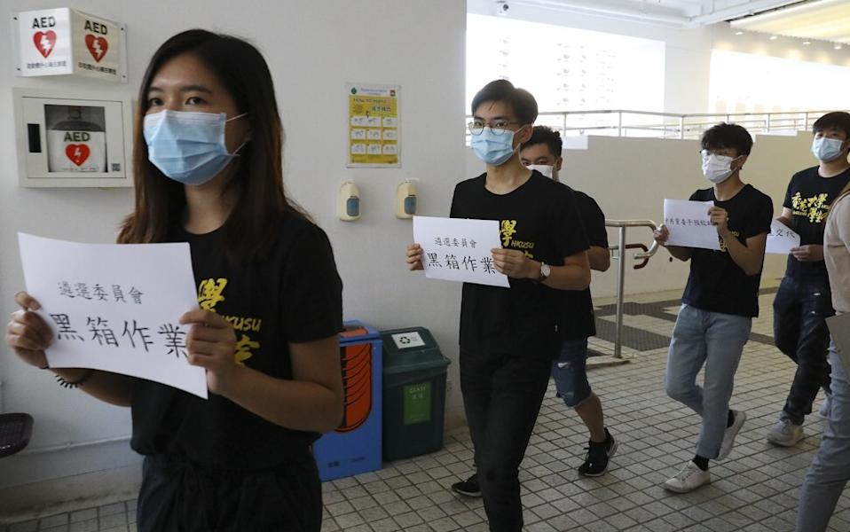 Students register their anger outside the Knowles Building on Tuesday over the appointments. Photo: Dickson Lee