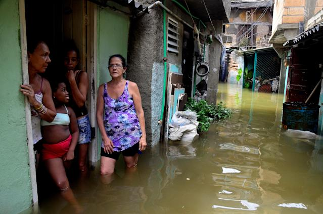 <p>Cubans stand in their flooded home in Havana, on Sept. 10, 2017. (Photo: Abel Ernesto/AFP/Getty Images) </p>