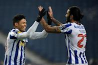 Porto captain Sergio Oliveira (R) has scored three times in the past four league matches